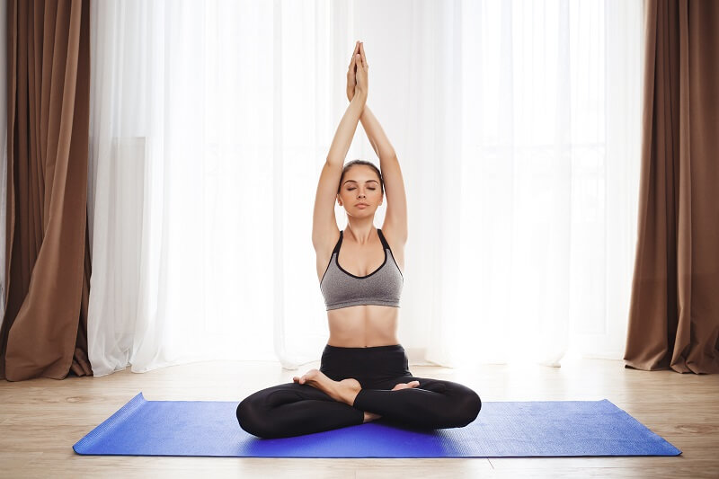 a woman is doing yoga